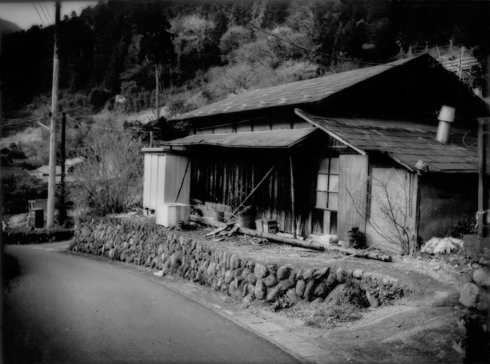 A common sight: an abandoned house farmhouse in a narrow valley near Chichibu, Mitsumine, Saitama, Japan.  There were four abandoned houses in this village of 11 house.  All around Japan, there is an exodus from the countryside to the city, leaving behind dying villages inhabited by senior citizens.  There is even less opportunity in hard times for younger generations to stay.
