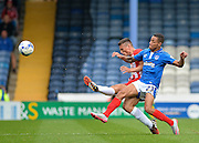 Matty Pearson beats Kyle Bennett to the ball during the Sky Bet League 2 match between Portsmouth and Accrington Stanley at Fratton Park, Portsmouth, England on 5 September 2015. Photo by Adam Rivers.