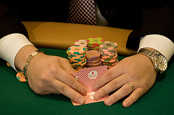 Hands and cards of poker hand at Nevada, Caesars Palace and Casino, gaming, gambling, poker, model released, NV, Las Vegas, Photo nv216-18004..Copyright: Lee Foster, www.fostertravel.com, 510-549-2202,lee@fostertravel.com