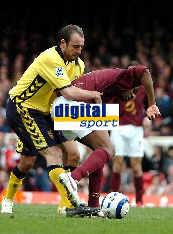 Photo: Ed Godden.<br />Arsenal v Aston Villa. The Barclays Premiership. 01/04/2006. Gavin McCann (L) pulls back Abou Diaby (Arsenal)