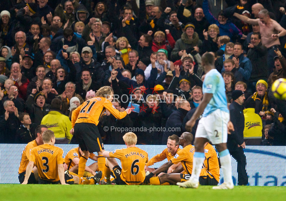 MANCHESTER, ENGLAND - Saturday, November 28, 2009: Hull City's Jimmy Bullard celebrates his equalising goal by mimicing manager Phil Brown's half-time dressing down of the players at the same venue 12-months earlier during the Premiership match against Manchester City at the City of Manchester Stadium. (Photo by David Rawcliffe/Propaganda)