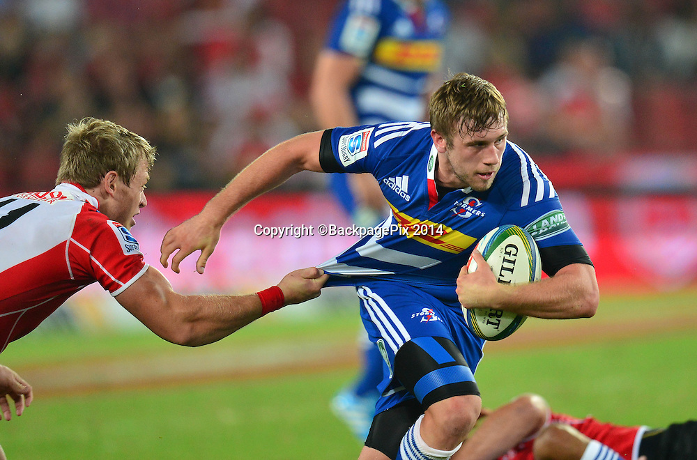 Michael van der Spuy of the Stormers challenged by Ruan Combrinck of the Lions  during the Super rugby match between the Lions and the Stormers at Ellis Park, Johannesburg on 22 February 2014 ©Gavin Barker/BackpagePix