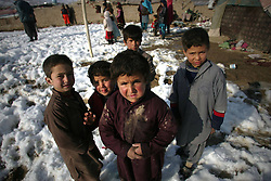 Seven-year-old Sami Allah plays with his friends near his home in Kabul, Afghanistan, on Jan. 13, 2013. More than 8.4 million Afghan children, of whom 39 percent are girls, presently attend school, while 4.2 million others have no access to school mainly due to security reasons and poverty, January 13, 2013. Photo by Imago / i-Images...UK ONLY
