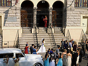 bride waiting on the steps of the church for groom to arrive