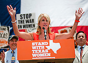 Texas Sen. Wendy Davis (D) speaks at a women's rights rally before a Special Session of the Texas Legislature in Austin, Texas, 01 July 2013. Texas Governor Rick Perry called a Special Session of the Texas Legislature relating to the regulation of abortion procedures, providers and facilities in Texas after lawmakers missed a deadline to vote on 25 June 2013 after a eleven hour filibuster by Senator Wendy Davis.