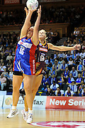 Catherine Latu and Laura Geitz compete for the ball ~ Netball action from ANZ Championship Grand Final - Queensland Firebirds v Northern Mystics - played at the Brisbane Convention Centre on Sunday 22nd May 2011 ~ Photo : Steven Hight (AURA Images) / Photosport
