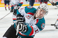 KELOWNA, CANADA - MARCH 23: Carter Rigby #11 of the Kelowna Rockets takes a shot during warm up against the Tri-City Americans on March 23, 2014 at Prospera Place in Kelowna, British Columbia, Canada.   (Photo by Marissa Baecker/Shoot the Breeze)  *** Local Caption *** Carter Rigby;