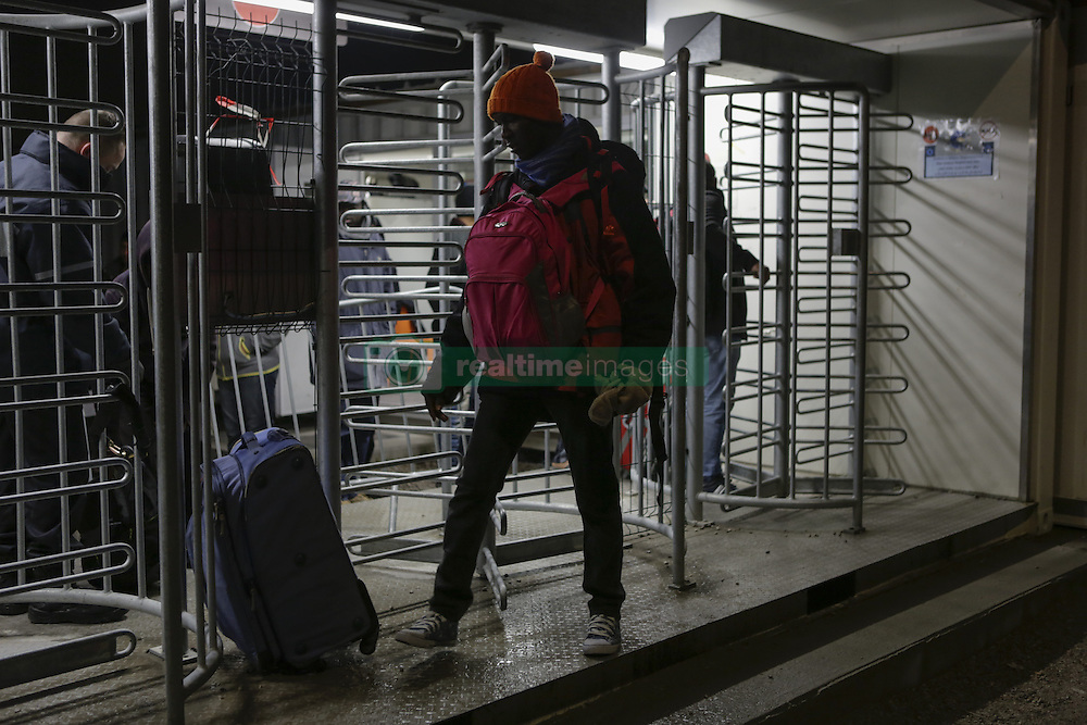 October 24, 2016 - Calais, Nord-Pas-de-Calais-Picardie, France - A refugee with his bags leaves the official camp, to go the Reception and Orientation Centre near the Jungle, from where he will be distributed to one of the different centres in France. The French state has started processing the inhabitants of the Jungle refugee camp in Calais and distribute them to centres around France. Not all of the 6 to 10 thousand refugees living in the Jungle (according to different estimates) are expected to leave voluntarily and some have already disappeared. (Credit Image: © Michael Debets/Pacific Press via ZUMA Wire)
