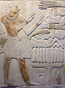 Egyptian wall relief. Depicting figures giving food and offerings. Also multiple Hieroglyphics. 26th Dynasty (approx. 600 BC) Egyptian.