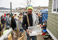 First year derby participant Ed Teague of Goffstown checks into Derby Headquarters at 2:50 pm Sunday afternoon with a 3.15 lb Rainbow Trout to earn a 5th place finish during the award ceremony at the Great Meredith Rotary Ice Fishing Derby.  Teague's rainbow trout was caught on Stinson Lake in Rumney.  (Karen Bobotas/for the Laconia Daily Sun)