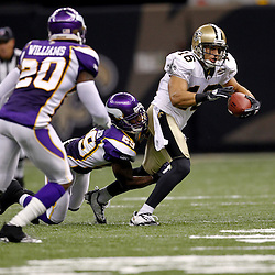 September 9, 2010; New Orleans, LA, USA;  New Orleans Saints wide receiver Lance Moore (16) is tackled by Minnesota Vikings cornerback Lito Sheppard (29) during the NFL Kickoff season opener at the Louisiana Superdome. The New Orleans Saints defeated the Minnesota Vikings 14-9.  Mandatory Credit: Derick E. Hingle