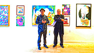 Huntington, NY, USA. March 29, 2019. L-R, Juror Benjamin Owens and Huntington Arts Council Executive Director Marc Courtade address visiters during HAC Opening Reception for Bright Colors Bold Strokes, Creations of Lowbrow Art Exhibition.