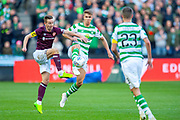 Steven MacLean (#18) of Heart of Midlothian and Kristoffer Ajer(#35) of Celtic FC during the Betfred League Cup semi-final match between Heart of Midlothian FC and Celtic FC at the BT Murrayfield Stadium, Edinburgh, Scotland on 28 October 2018.