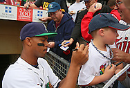 Kernels Center Fielder Byron Buxton (7) signs the shirt of a young fan before the start of a game between the Cedar Rapids Kernels and the Quad Cities River Bandits at Veterans Memorial Stadium in Cedar Rapids, Iowa on June 5, 2013.