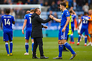 Leicester City manager Brendan Rodgers congratulates Leicester City defender Harry Maguire (15) at the end of the game during the Premier League match between Leicester City and Arsenal at the King Power Stadium, Leicester, England on 29 April 2019.