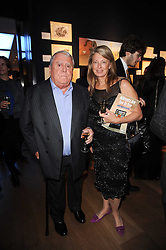 MR & MRS ALBERT ROUX at an auction and priavte view of paintings, drawings, stories and doodles by well known personalities held at Christie's, St.James's, London on 20th September 2010.