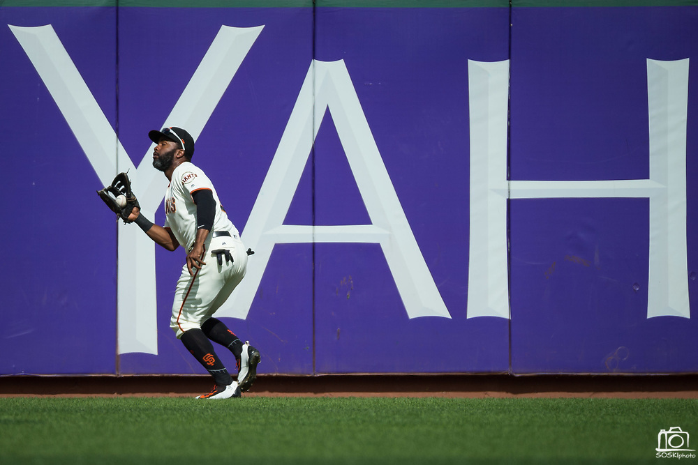 San Francisco Giants center fielder Denard Span (2) catches a Colorado Rockies fly ball at the warning track at AT&T Park in San Francisco, California, on September 20, 2017. (Stan Olszewski/Special to S.F. Examiner)