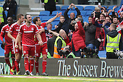 Middlesbrough FC striker Christian Stuani celebrates with the crowd after scoring Middlesbroughs third goal during the Sky Bet Championship match between Brighton and Hove Albion and Middlesbrough at the American Express Community Stadium, Brighton and Hove, England on 19 December 2015. Photo by Geoff Penn.