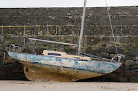 Sail boat moored at the pier in Spiddle County Galway Ireland at low tide