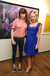 Left to right, sisters STORM LONSDALE and TAMSIN LONSDALE at an exhibition of Tahnee Lonsdale's paintings held at The Commander, 47 Hereford Road, London on 8th October 2008.