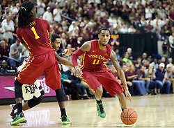 Iowa State's Monté Morris (11) drives the lane as Texas A&M's Anthony Collins (11) is blocked by Iowa State's Jameel McKay (1) during the second half of an NCAA college basketball game, Saturday, Jan. 30, 2016, in College Station, Texas. Texas A&M won 72-62. (AP Photo/Sam Craft)