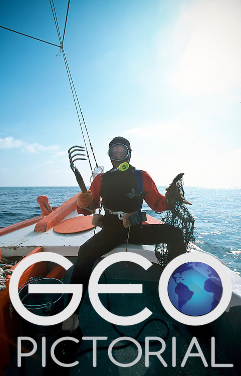 Tarpon Springs, Florida, USA; August 2003;.Greek sponge diver from Kalymnos island, Captain Lefteris Kambourakis prepares to dive for sponges in the Gulf of Florida.