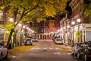 Historic downtown Gardiner is seen illuminated by street lamps in this night scene of Main Street.