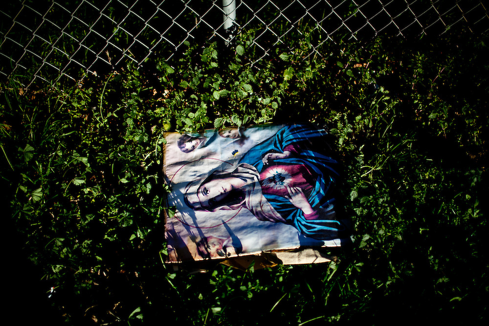 A picture of the Virgin Mary is discarded in the Parklawn neighborhood of Modesto, Calif., February 23, 2012.