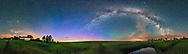A 360&deg; panorama of the summer solstice sky, taken from home at latitude 51&deg; North, at 1:00 a.m. on the night of June 22/23, 2017, with an abundance of sky glows: <br /> - The yellow and blue glow to the north, at centre, of perpetual twilight (the sky never gets astronomically dark)<br /> - A minor display of northern lights adding green and magenta to the north<br /> - Some faint green bands of airglow to the west (far left) and east (right of centre)<br /> - And the Milky Way arching across the sky from NE to SW.<br /> - Light pollution lights the clouds yellow from sodium vapour lamps.<br /> <br /> However, there were no noctilucent clouds this night, which would have addded another form of solstice skyglow. <br /> <br /> Highlights include:<br /> - The Big Dipper and Arcturus are at far left - a satellite pierces the handle of the Big Dipper<br /> - Polaris is left of centre<br /> - the Summer Triangle stars are at right of centre straddling the Milky Way <br /> - Saturn is at far right above the horizon in the Milky Way<br /> - the Galactic Centre is in the south at far right low on the horizon as it is from this latitude<br /> - the Andromeda Galaxy is rising in the NE at centre.<br /> <br /> This is a stitch of 6 segments, each with the 12mm Rokinon full-frame fish-eye lens, horizontally framed, on the Nikon D750, all 40 seconds at f/2.8 and ISO 3200. Stitched with PTGui. Shot from home in southern Alberta.