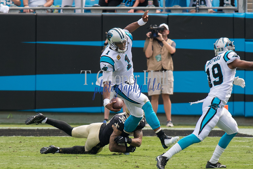 Cam Newton(1) breaks a tackle from Kenny Vaccaro(32) in the New Orleans Saints 34 to 13 victory over the Carolina Panthers.