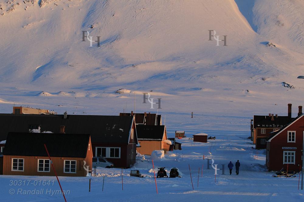 Late evening April sun lights the international science village of Ny-Alesund on Spitsbergen island in Kongsfjorden; Svalbard, Norway.