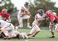 Elkhorn, Nebraska --<br /> <br /> Beatrice quarterback Cooper Blum (6) hurdles over Elkhorn defenders during their football game at Elkhorn High School on Friday, Sept. 9, 2016, in Elkhorn. Elkhorn defeated Beatrice 42-7.<br /> <br /> MATT DIXON/THE WORLD-HERALD