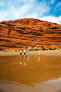 LEGZIRA, MOROCCO - 05th June 2016 - Tourists enjoying a visit to Legzira Beach. Located between Mirleft and Sidi Ifni in the Tiznit Province of Southern Morocco, Legzira is one of the most famous and popular beaches in Morocco.