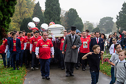 © Licensed to London News Pictures. 26/10/2017. Epsom, UK. Mourners wearing Manchester United shirts carrying the coffin at the funeral of Tom 'Tomboy' Doherty, the nephew of Big Fat Gypsy Weddings star Paddy Doherty, at Epsom Cemetery in Epsom, Surrey. Tom Doherty was 17 when he was killed in a car crash in South Nutfield in Surrey on October 9. He had passed his driving test just days earlier. Photo credit: Ben Cawthra/LNP