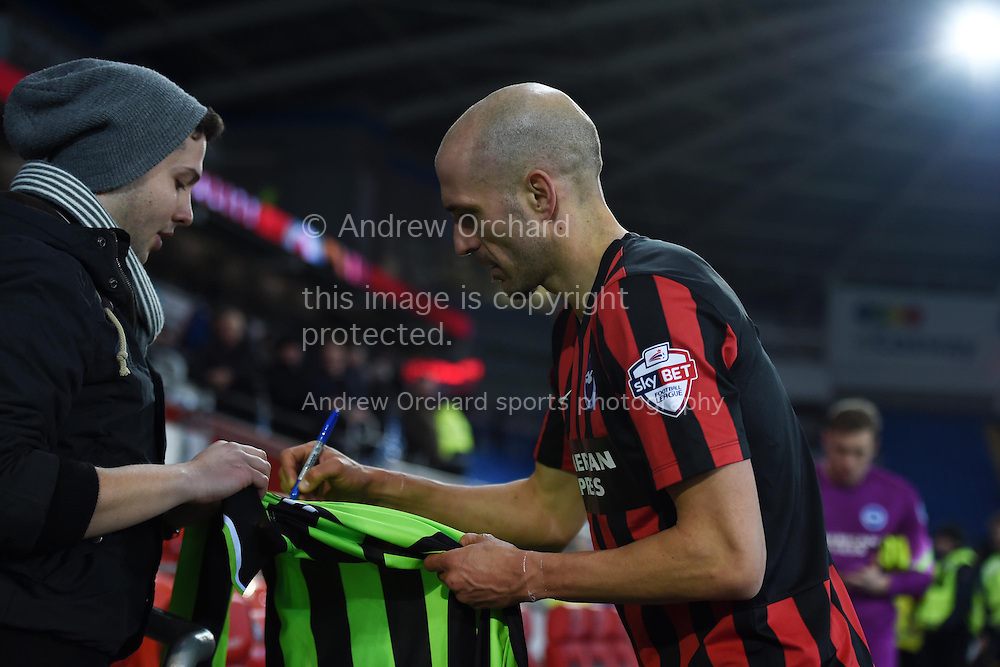Bruno Saltor of Brighton signs a fans shirt at end of the match. Skybet football league championship match, Cardiff city v Brighton &amp; Hove Albion at the Cardiff city Stadium in Cardiff, South Wales on Tuesday 10th Feb 2015.<br /> pic by Andrew Orchard, Andrew Orchard sports photography.
