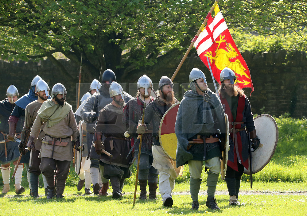 © Licensed to London News Pictures. 20/04/2019. Glastonbury, UK. Participants playing Saxon Warriors, prepare to take the field of battle at Glastonbury Abbey Medieval Fayre on Easter bank holiday weekend.  Photo credit: Jason Bryant/LNP