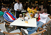 A soccer fan is blasted with a vuvuzela at a restaurant in Sandton. Thousands of South African's had filled the streets of Sandton  to cheer on the national team Bafana Bafana, two days their opening match of the world cup. Sandton is the wealthiest area of Johannesburg and home to the South African financial district. ..South Africa. Wednesday 9th June 2010..Pictures by Zute Lightfoot and Demelza Lightfoot. www.lightfootphoto.com.+27(0)719595 7308    +27(0)719595 7313 zutelightfoot@yahoo.co.uk..