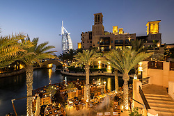 Evening view of Madinat Jumeirah and Burj al Arab Hotel in Dubai United Arab Emirates