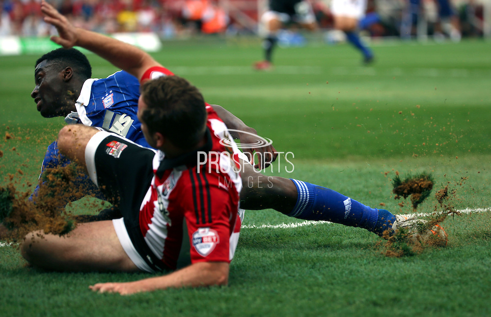 Alan Judge further tearing up the pitch during the Sky Bet Championship match between Brentford and Ipswich Town at Griffin Park, London, England on 8 August 2015. Photo by Matthew Redman.