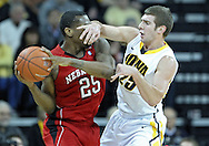 January 26, 2012: Nebraska Cornhuskers guard Caleb Walker (25) tries to pass around Iowa Hawkeyes guard/forward Eric May (25) during the NCAA basketball game between the Nebraska Cornhuskers and the Iowa Hawkeyes at Carver-Hawkeye Arena in Iowa City, Iowa on Thursday, January 26, 2012.