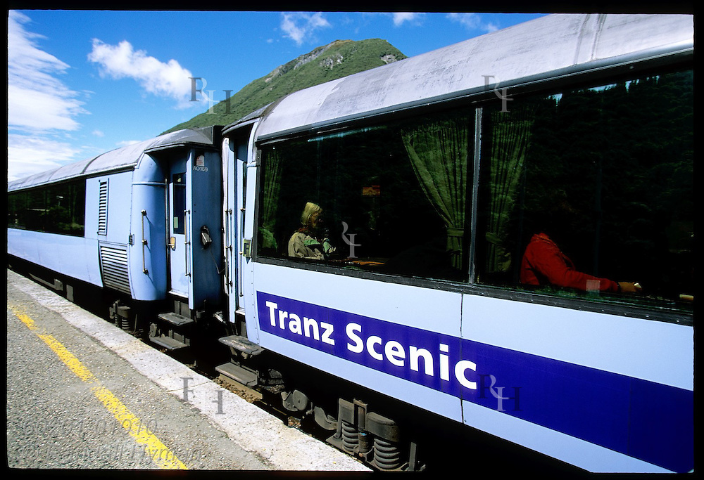 Passengers await departure of TranzAlpine Express train during its stop at Arthur's Pass village in the Southern Alps; NZ