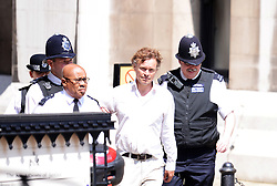 A unidentified man is arrested for heckling The Royal Courts of Justice in London, UK Monday 28th May  2012..Today former Labour Prime Minister Tony Blair is giving evidence to The Leveson Inquiry into press standards at The High Court...Photo i-Images.