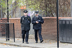 © Licensed to London News Pictures. 14/11/2017. London, UK. Police officers walk within the police cordon at Monteagel Way, Nightingale Estate in Hackney this morning. Police were called by London Ambulance Service to reports of a stabbing at Monteagle Way, Nightingale Estate in Hackney at around 0001hrs today. At the scene a 21-year-old male was treated by medical professionals for a stab wound to the chest. The man died at the scene at 0015hrs. Photo credit: Vickie Flores/LNP