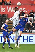 Swansea City midfielder Leroy Fer (8) beats Ipswich Town defender Matt Pennington (5) to the ball during the EFL Sky Bet Championship match between Swansea City and Ipswich Town at the Liberty Stadium, Swansea, Wales on 6 October 2018.