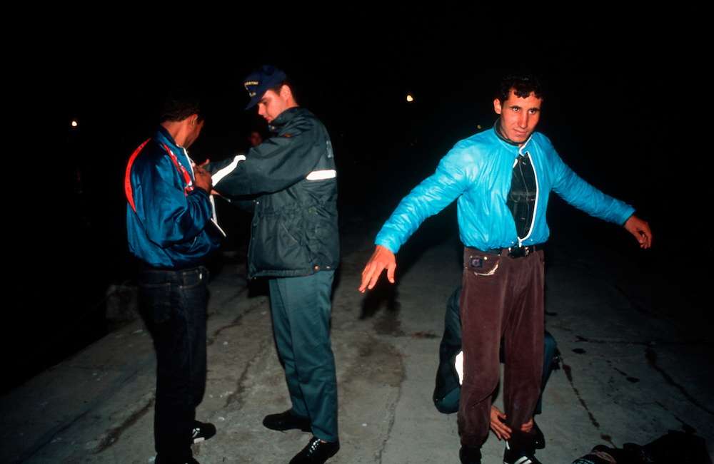 Illegal immigrants being checked by the Spanish Guardia Civil after their  boat was apprehended during a nocturnal attempt to enter Spain and the European Union by crossing of the Strait of Gibraltar from Morocco.<br />