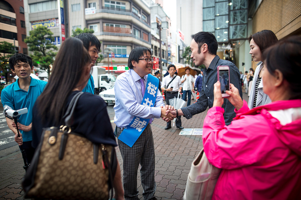 TOKYO, JAPAN - JULY 21 : Candidate Makoto Sakurai, a Japanese ultranationalist and far-right activist greets people after his campaign speech during a Tokyo Gubernatorial Election 2016 campaign rally at Omori station, Tokyo, Japan on Thursday, July 21, 2016. Tokyo residents will vote on July 31 for a new Governor of Tokyo who will deal with issues related to the hosting of the Tokyo Summer Olympics and Paralympics in 2020. (Photo: Richard Atrero de Guzman/NUR Photo)
