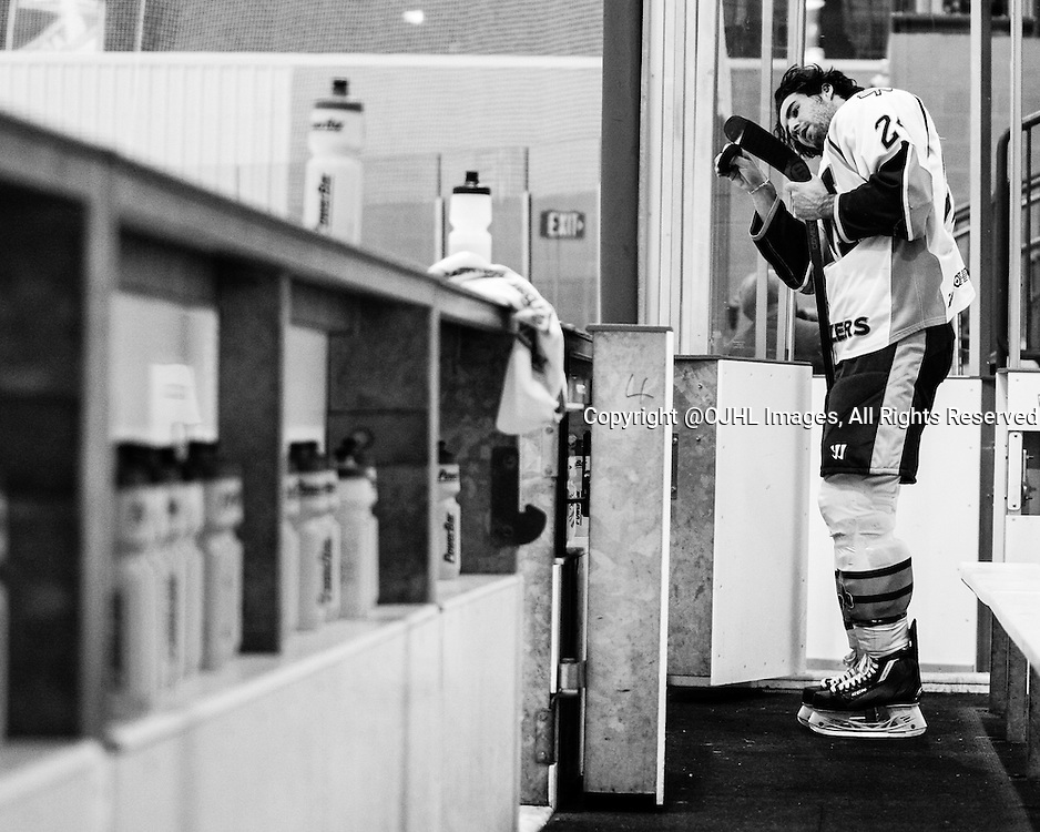 Oakville, ON - Oct. 9 2015 : Ontario Junior Hockey League game action between Oakville and St. Michaels. Michael Andlauer #24 of the St.Michael's Buzzers tapes his stick before the game. (Photo by Kevin Sousa/OJHLimages)