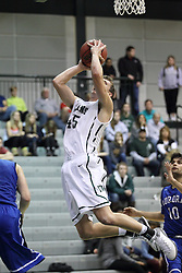 16 November 2013:  Michael Mayberger clears the lane as he takes a shot during an NCAA mens division 3 basketball game between the Aurora University Spartans and the Illinois Wesleyan Titans in Shirk Center, Bloomington IL