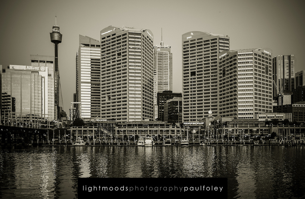 Reflections of Sydney, Australia in waters of Darling Harbour