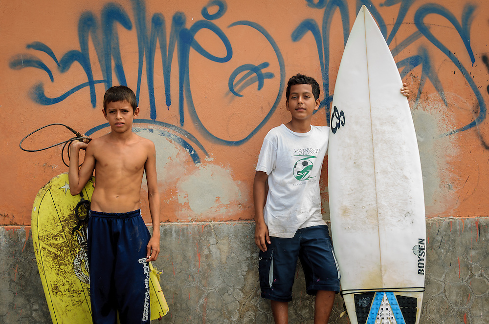 Two boys with surf boards, El Tunco El Salvador